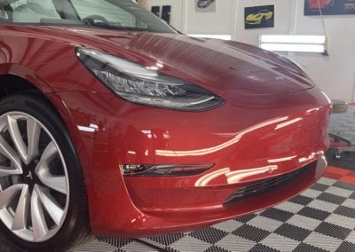 Photos of a New Car Preparation of a 2019 Tesla Model 3